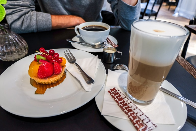 coffee and fruit tart on cafe table in munich