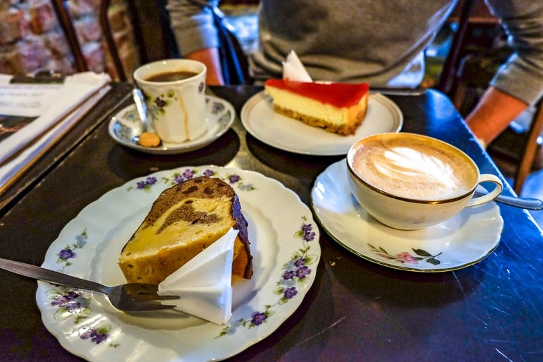 cake and coffees on table in cafe for breakfast one day in munich