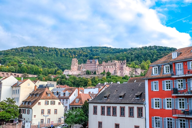 red castle sitting high up on hill above old town things to do in heidelberg germany