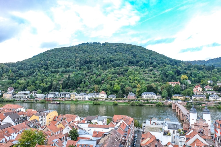 green hill with houses and river at the base in heidelberg germany