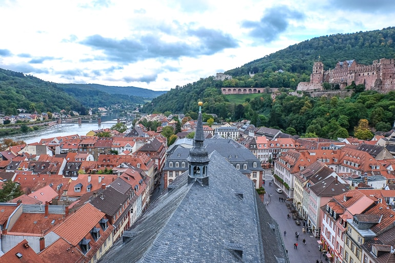church roof with small tower overlooking roofs of german old town heidelberg germany