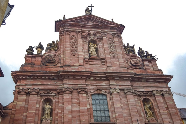 red stone church entrance with grey sky behind heidelberg germany