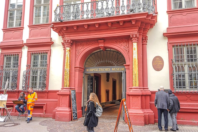 red and white arch entrance to old museum in old town things to do in heidelberg germany