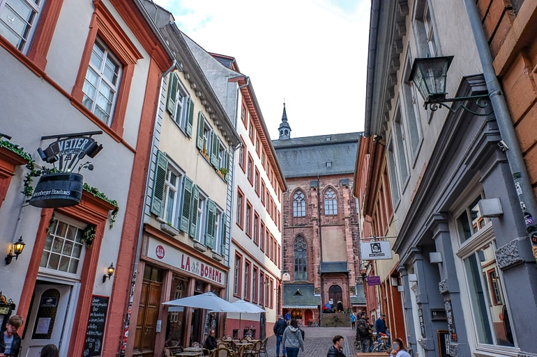 colourful buidings down alleyway with shops in heidelberg germany