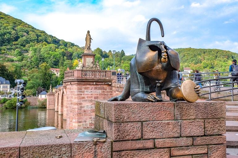 bronze monkey on end of old red bridge heidelberg germany