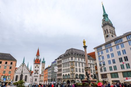 old town buildings with clocks and towers in marienplatz where to stay in munich