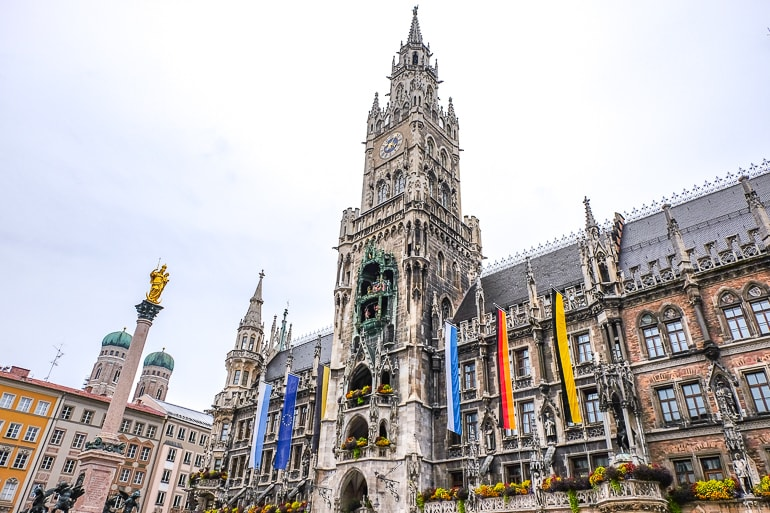 old town hall tower with clock and flags marienplatz where to stay in munich