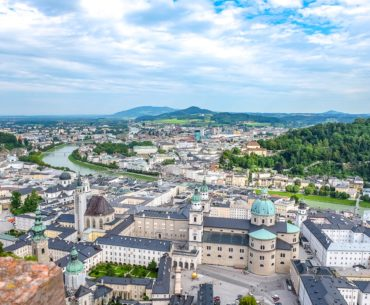 building roofs in city with river running through centre where to stay in salzburg austria old town