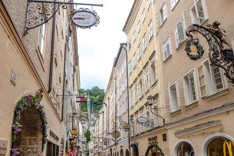 old signs hanging along old town street salzburg austria