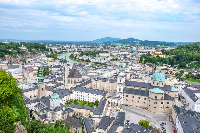 large cathedral with green domes and old town buildings in salzburg austria where to stay