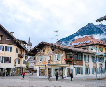 colourful chalet house in village with mountain behind in garmisch germany day trip from munich