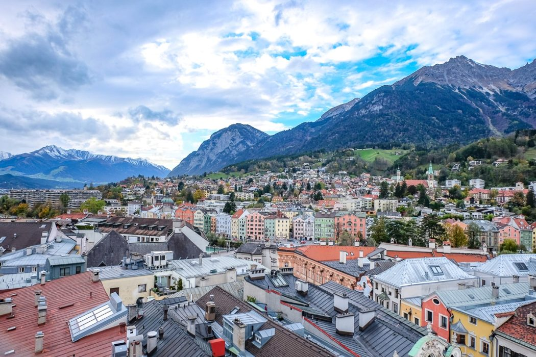 colourful houses in town from above with mountains nehind innsbruck day trips from munich