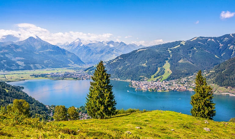 blue lake with small town at shoreline and mountains behind zell am see austria