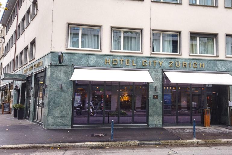 green hotel exterior on zurich street front