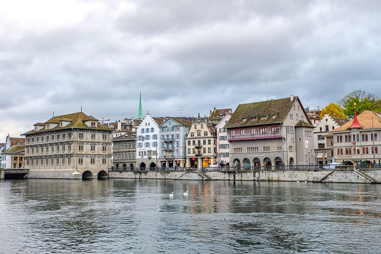 old town buildings and rathaus along river front in zurich switzerland