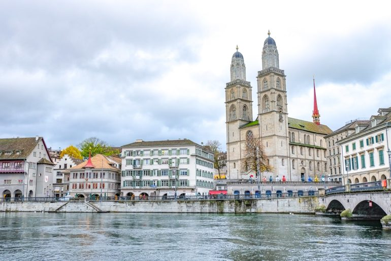 cathedral with two towers in old town by river one day in zurich