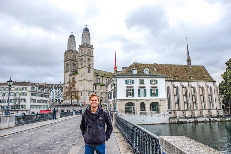man in front of cathedral in old town zurich