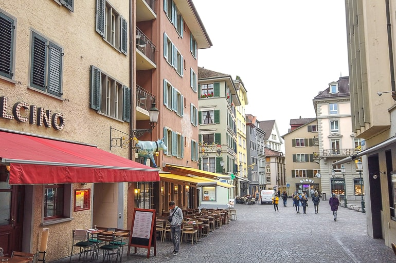 shop fronts in busy old town street in zurich