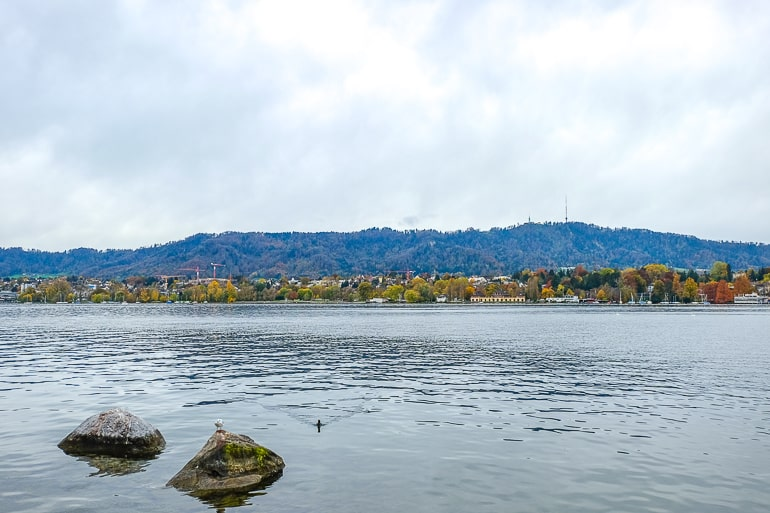 large mountain in distance with lake in front in zurich