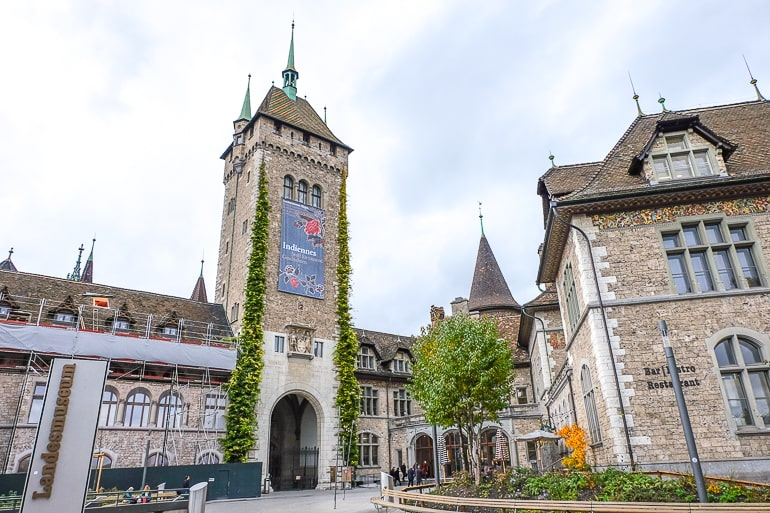 museum entrance with archway and tower in zurich