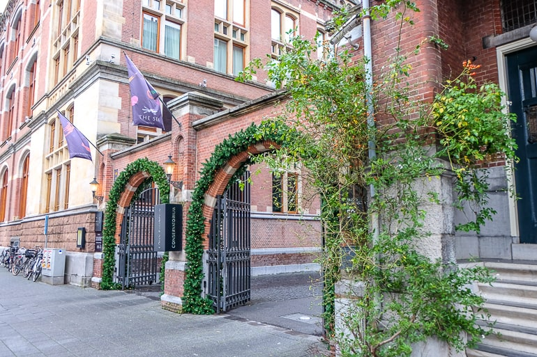 two red brick arches with green vines covering