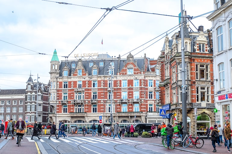 red brick luxury hotel in busy city centre amsterdam