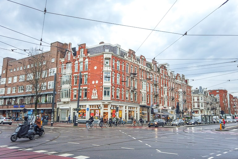 red brick buildings at busy intersection with cars in amsterdam oud west
