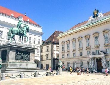 horse statue in courtyard with historic buildings around where to stay in vienna