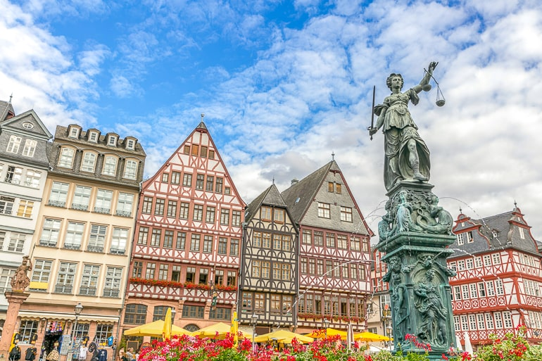 timbered buildings with statue in frankfurt old town germany itinerary