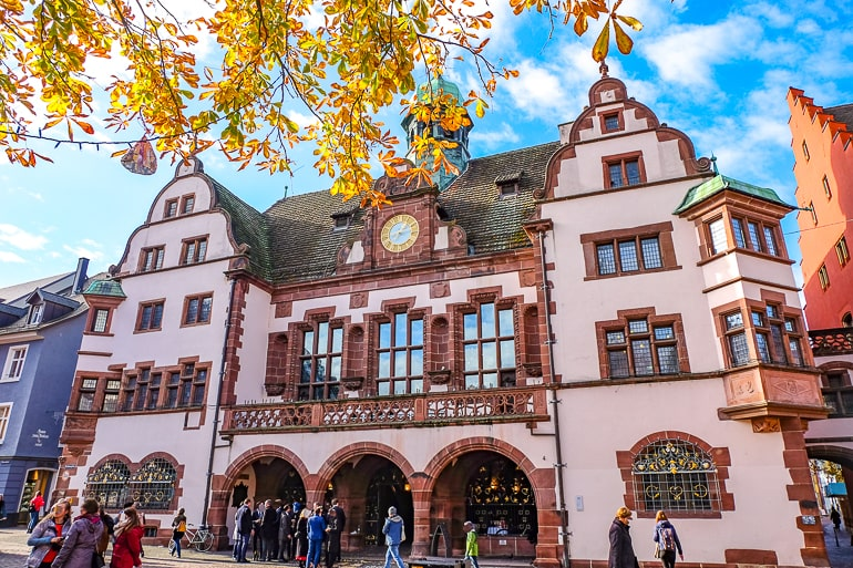 pink building in old town germany with autumn leaves around