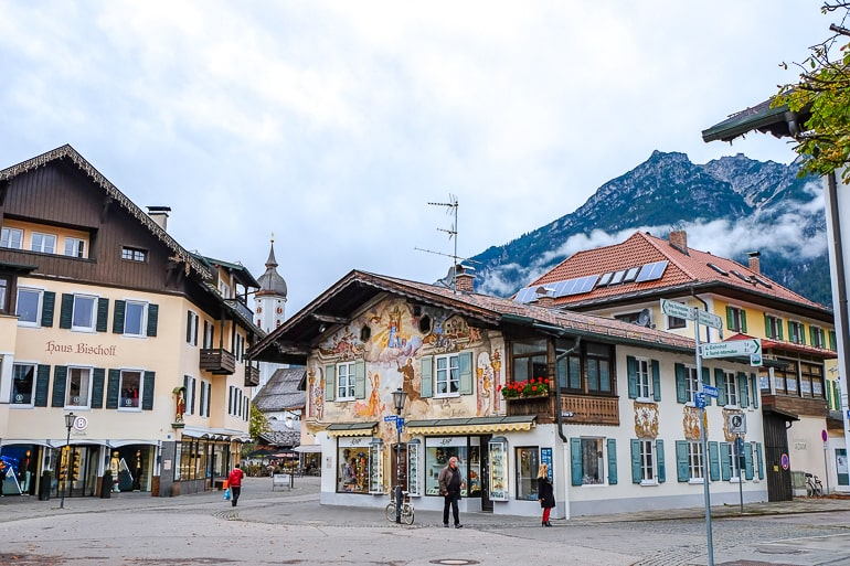 colourful ski chalet building with mountains behind in germany