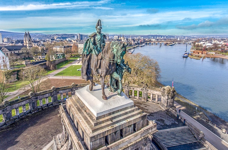 tall horse and rider statue overlooking river in koblenz germany