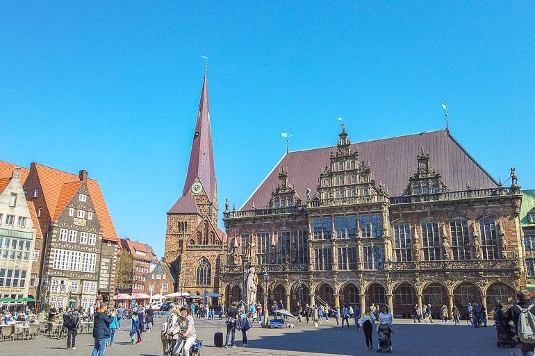 historic town hall and church tower in bremen town square