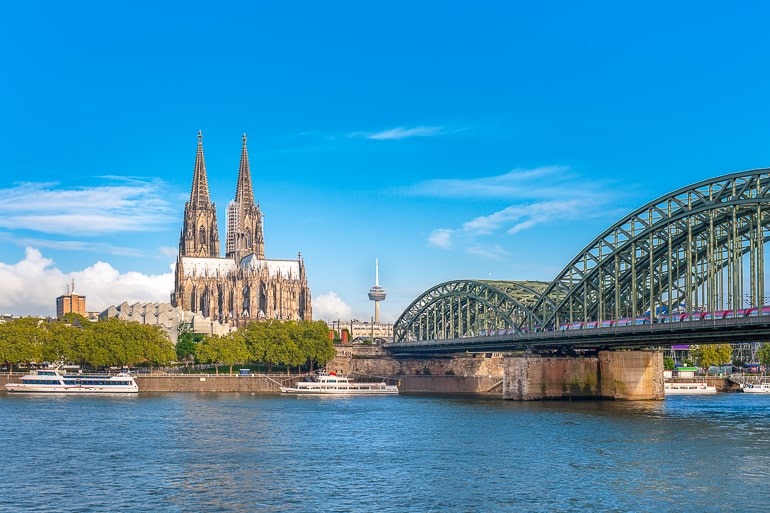 metal bridge over river with cathedral in background in cologne germany itinerary