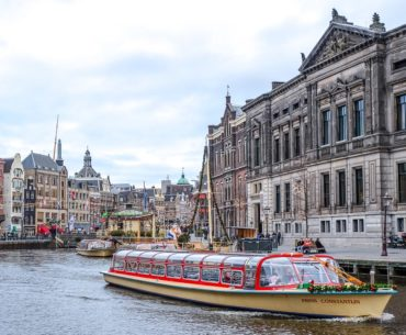 flat canal boat on water in city centre one day in amsterdam