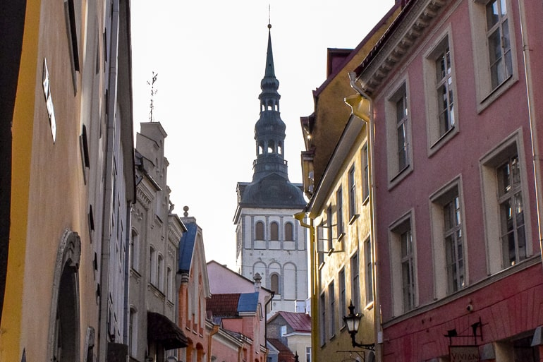 white church tower amongst colourful old town buildings tallinn estonia