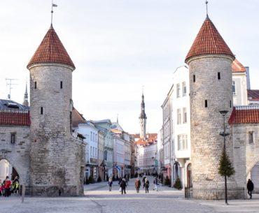 old stone gate to old town with orange tops one day in tallinn