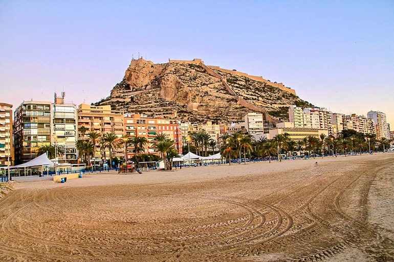 castle on top of rock with beach in front things to do in alicante spain