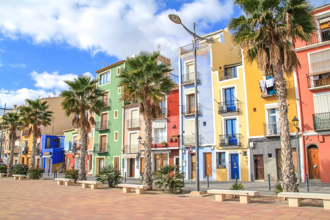 colourful houses with palm trees along boardwalk thing to do in alicante spain