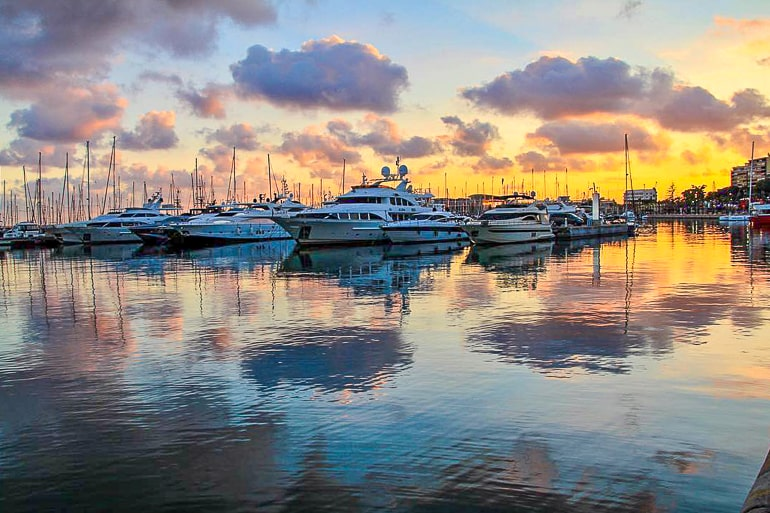 colourful sunset with boats in marina things to do in alicante spain