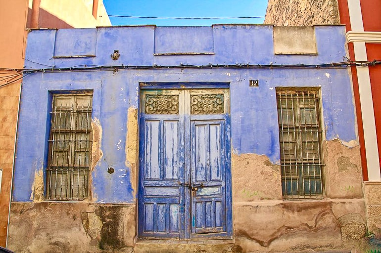 old wooden blue door to building in alicante old town things to do