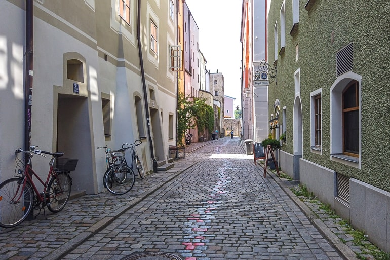 cobblestone street with painted art line in old town passau