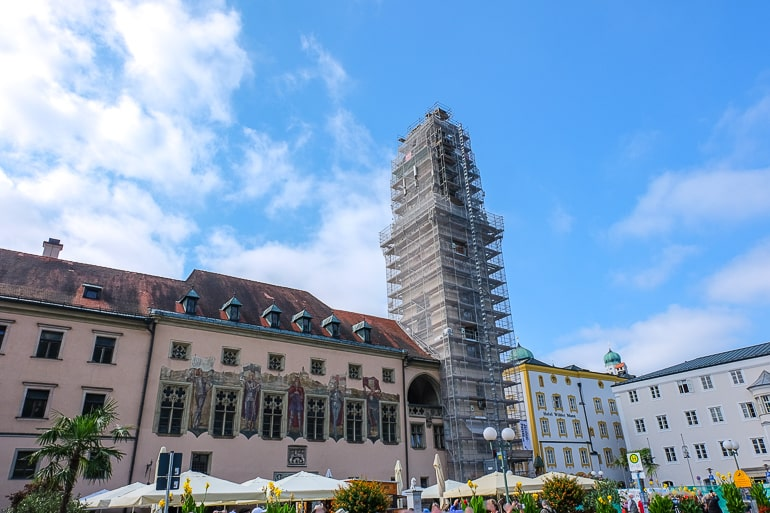 tall town hall tower under construction in german old town
