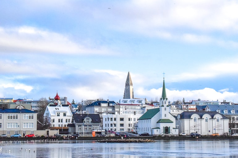 large church with museum building along lake front in reykjavik