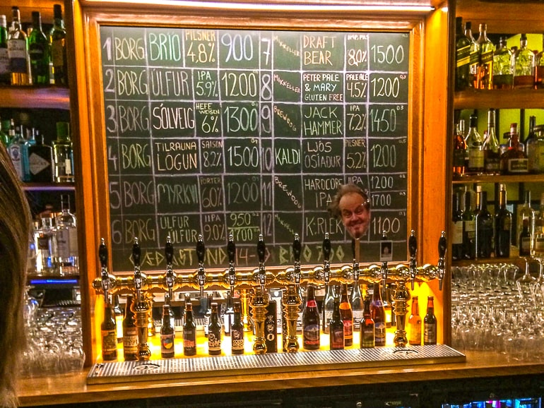 beer taps with chalkboard behind in bar in reykjavik