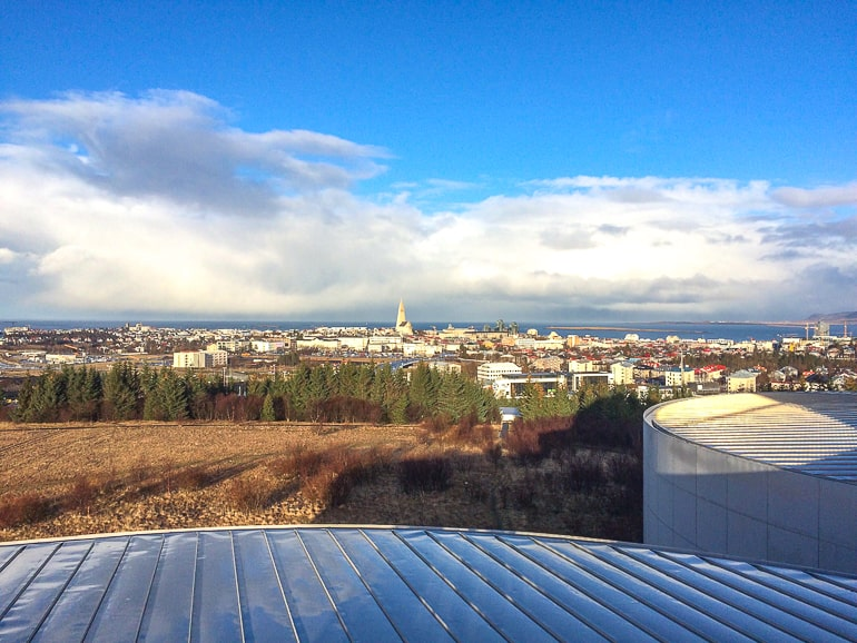 metal roof of observatory looking out over green landscape in reykjavik