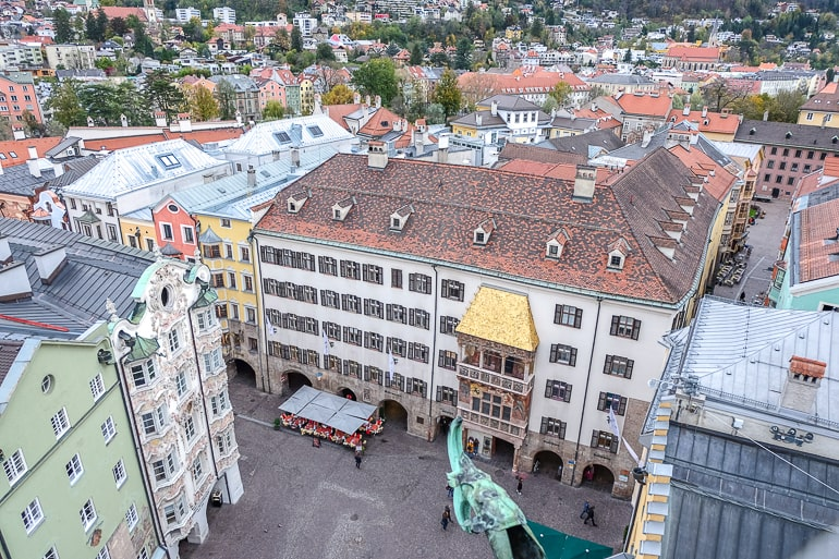 golden roof and old buildings seen from above in tower in innsbruck old town