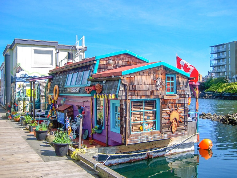 colourful house boat in harbour in victoria bc canada