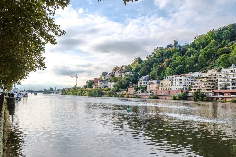 views of buildings and accommodations along neckar river in heidelberg germany