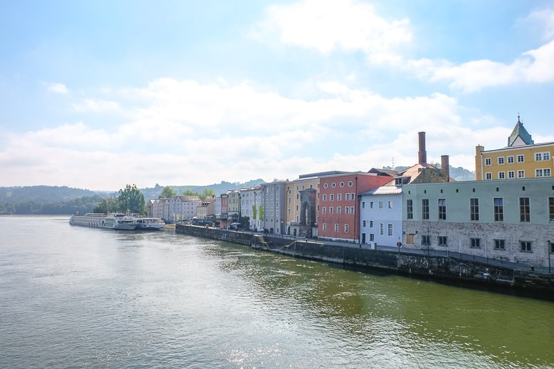 line of old colourful buildings by river in passau germany old town